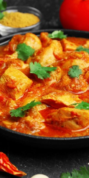 Chicken curry with different spices, closeup